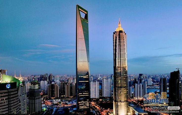 The Shanghai World Financial Center (left) is a supertall skyscraper located in the Pudong district of Shanghai, China.  It is a mixed-use skyscraper, consisting of offices, hotels, conference rooms, observation decks, and ground-floor shopping malls.