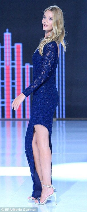 Leading lady... The Transformers actress teamed the stunning gown with a pair of silver he...