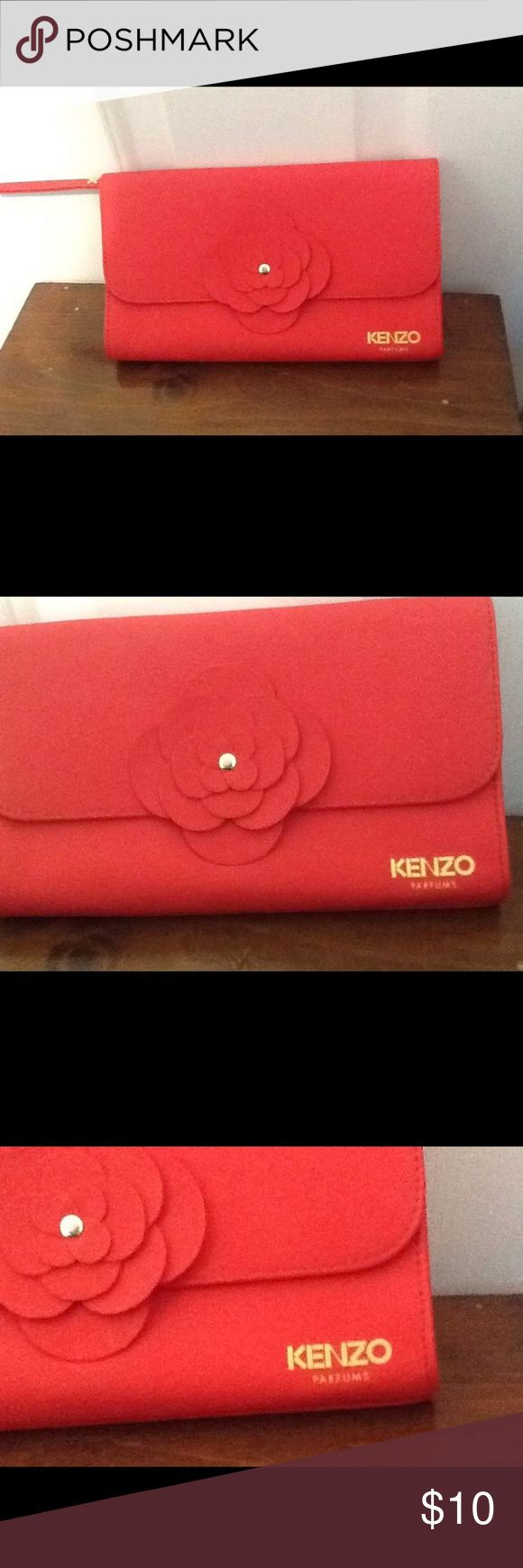 Kenzo Parfums Red Faux Leather Makeup Bag Kenzo Parfums Red Faux Leather With Flower Cosmetic Makeup Bag. New never been used. Kenzo Bags Cosmetic Bags & Cases