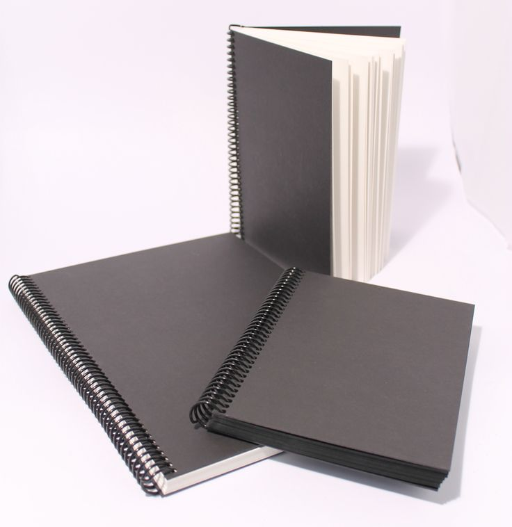 Black covered books with art paper inside. Fantastic quality. Made in the UK. http://www.southfield-stationers.com/stationery/notepads-184/