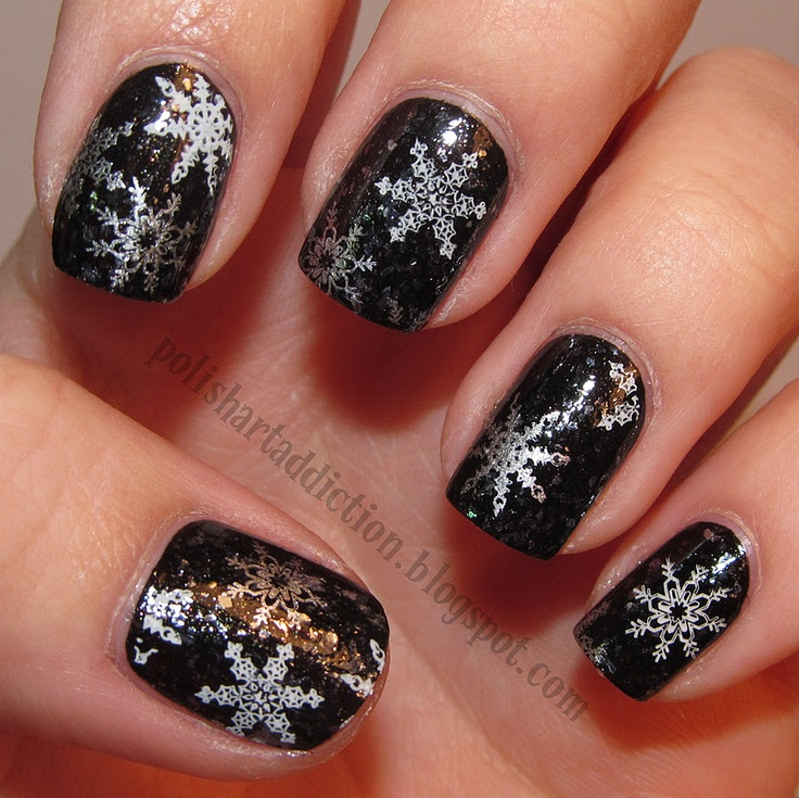 Black layered with Sally Hansen Diamond Strength Glass Slipper stamped with snowflakes from BM 14 and Konad M59 .