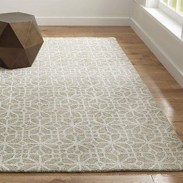 The intricate geometry of Chinese lattice carvings softens and updates as a room-friendly rug made of natural undyed wool. Designed by Madhulik and Manish Tibrewal, the loop-constructed rug blends soft wool with rayon for subtle sheen in a neutral palette that compliments any setting.