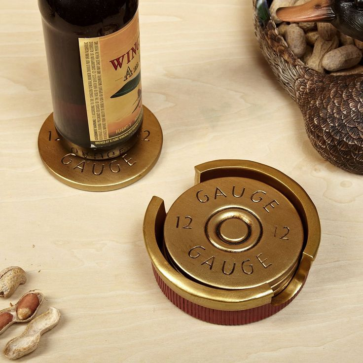 All tabletops need protection. Home Wetbar's shotgun shell coasters are sure to protect your coffee table at all times from watermarks and any harm that comes its way. Painted to resemble the ends of 12 gauge shotgun shells, this stone coaster set also includes a coordinating holder which is designed to look like the case of a shotgun shell. Made of polyresin stone, it's a great housewarming gift for hunters. No-slip grip padding is featured on each coaster to protect your tabletop from…