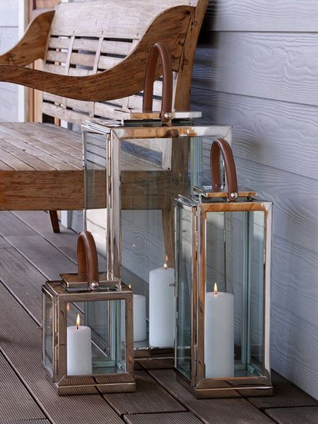 Love the clean look of these stainless and leather lanterns. Good mood lighting for deck or 3 season porch.