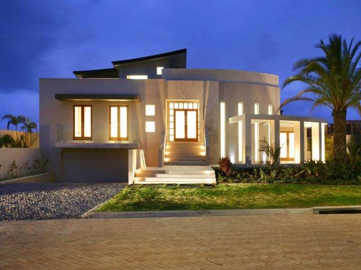 foto-fachada-de-casa-moderna-iluminada-al-anochecer.jpg (800×600)
