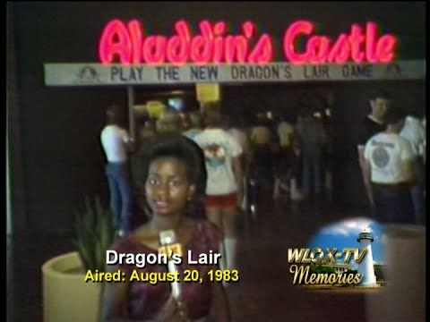 WLOX Memories   Dragons Lair   1983 #TBT WLOX Reporter Deborah Harris takes time out from the serious stories of the day to have a little fun with a new cutting edge arcade game that uses Laser Disc technology.  Who remembers Aladin's Castle arcade and the legendary Dragon's Lair game?  #ThrowbackThursday