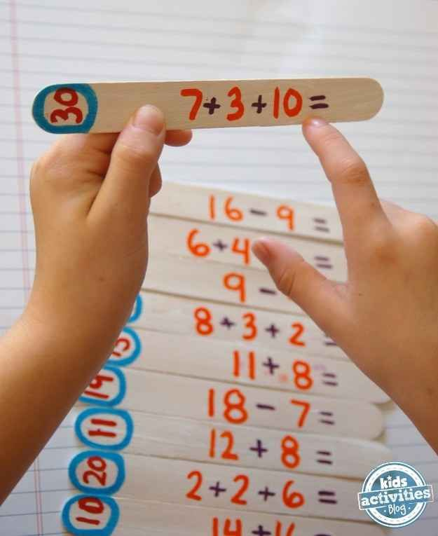 Make a math game out of craft sticks.