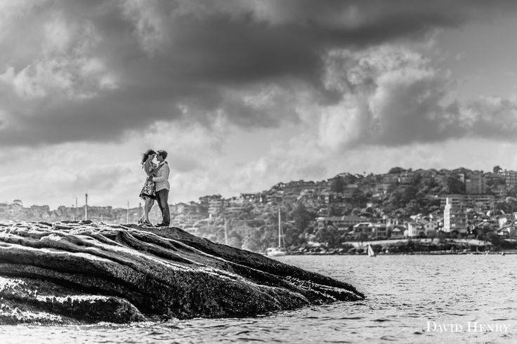 Manly engagement session as clouds roll in. Photo by David Henry Photography