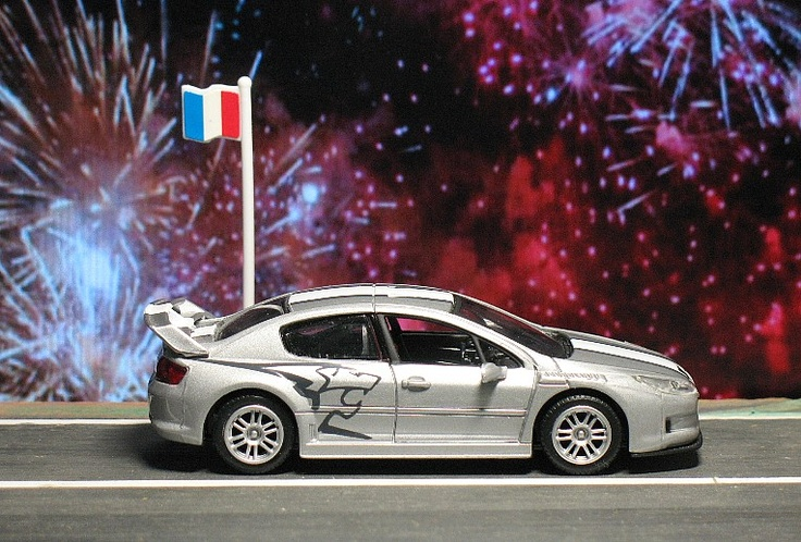 French national holiday, July 14, 2012. (die cast Motor Max, Peugeot 407 Silhouette)