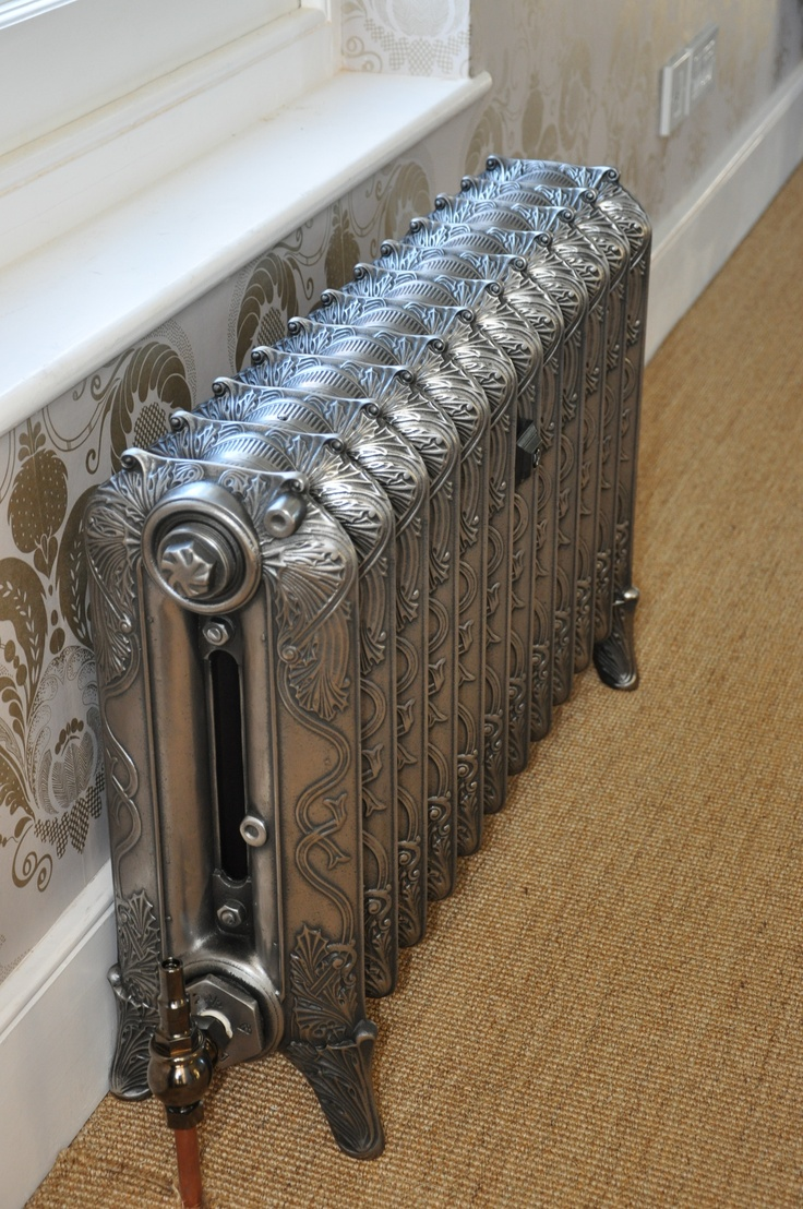 wonderful reclaimed art nouveau radiators similar to those in our house.  Ours have the ladies with long flowing hair and pretty scroll work.