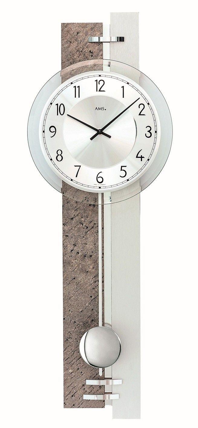 AMS Wandklok met slinger 7440. Mooie wandklok uitgevoerd in een houten behuizing met Natuursteen en is met Aluminium afgewerkt. Werkt op een batterij. De klok is 67 hoog, 23 cm breed en 7 cm diep. De wijzerplaat is zilverkleurig en de klok heeft gefacetteerd Mineraalglas. De slinger heeft geen invloed op de werking van de klok en mag desgewenst weggelaten worden. https://www.timefortrends.nl/wekkers-klokken/ams-klokken.html