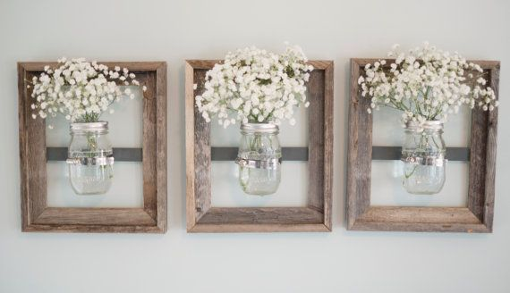 These mason jar frames are so chic and can be used to creatively organize or display anything in your home! Use them to display fresh cut flowers or herbs, candles, pens or kitchen utensils, Q-tips or cottonballs. A distressed wood frame holds a clear, glass mason jar and is sure to add character & style to any space! Each 8 x 10 wall mounted display is unique and made from a distressed open wood frame. No two frames are alike, each having their own rustic character. The mason jar is…