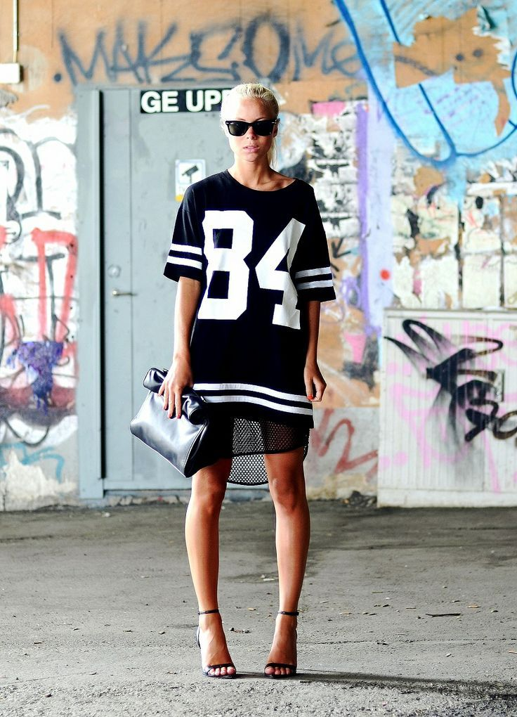 Super Bowl Style - How to Make a Sports Jersey Look Chic - black jersey over a mesh tunic + strappy black heels and a folded leather bag
