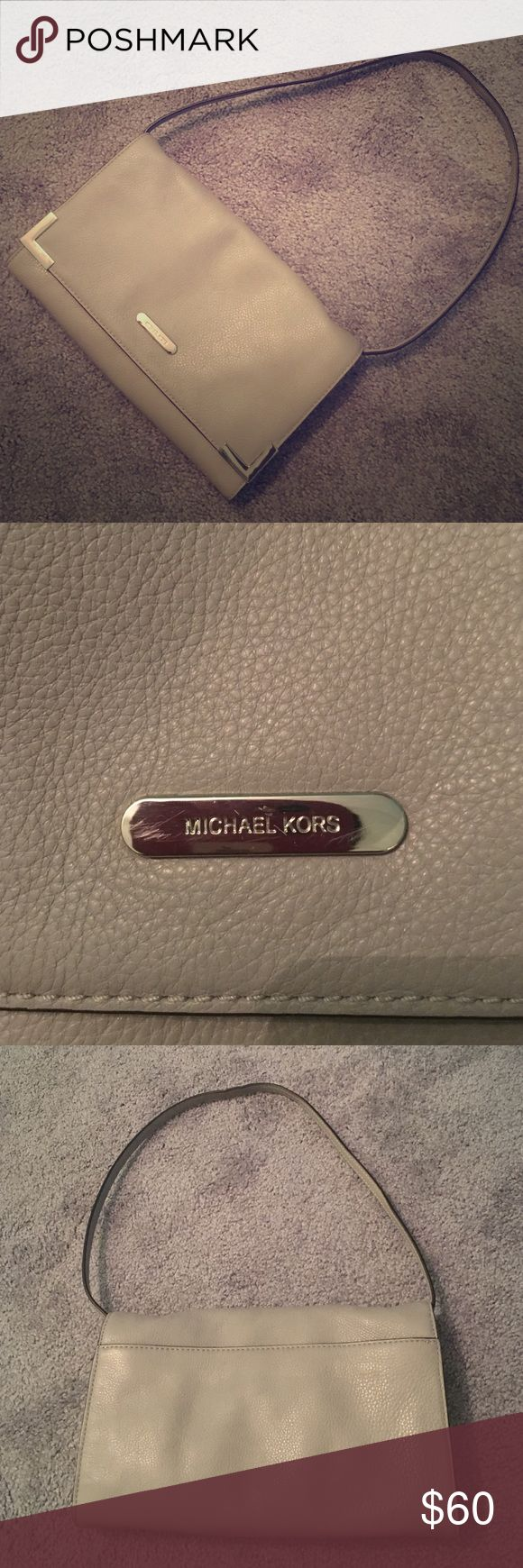 Like new Michael Kors small grey shoulder bag Like new Michael Kors small grey shoulder bag. Minor scratch on front hardware but definitely not noticeable. Used only once. Michael Kors Bags Shoulder Bags