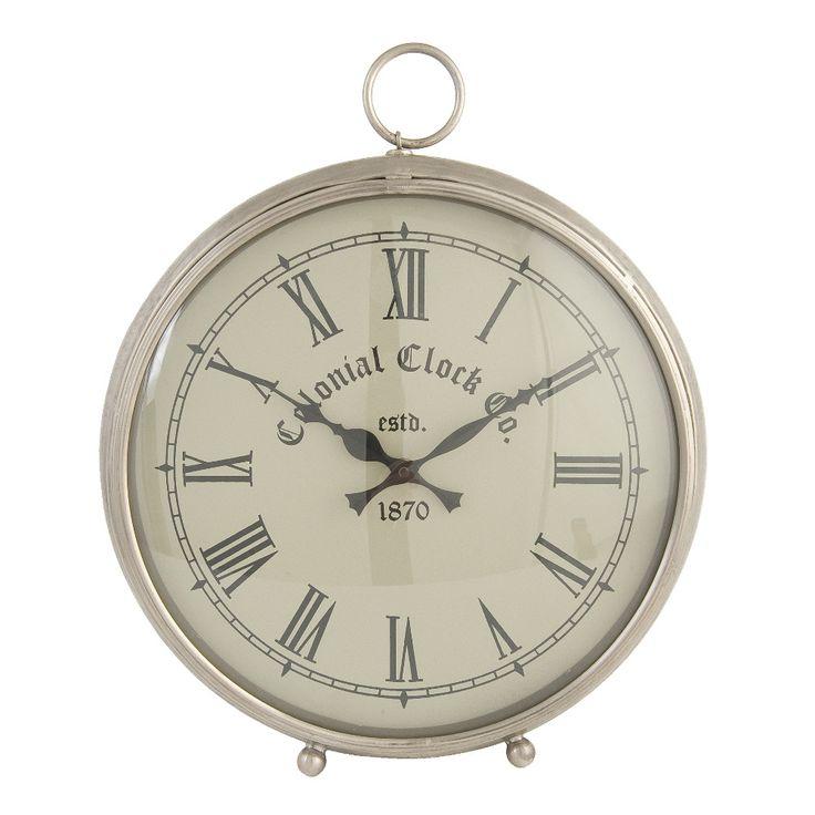 Una forma tonda per questo orologio da tavolo in zinco dalle tonalità naturali.