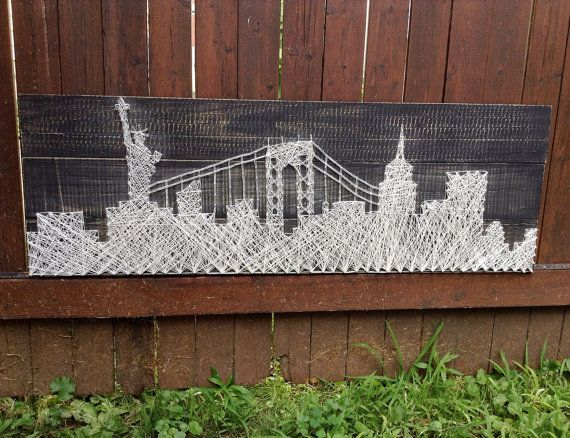 This NYC Skyline string art wooden piece measures 11 x 32. It makes a unique decorative piece to any NYC lovers home.  This wooden plaque is first