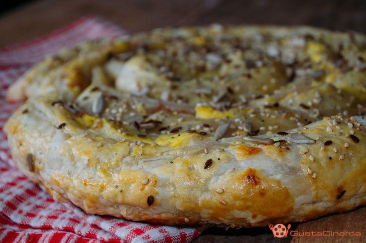 Torta a spirale di sfoglia con patate mortadella e philadelphia è un antipasto sfizioso e molto gustoso. Facile e veloce da preparare.