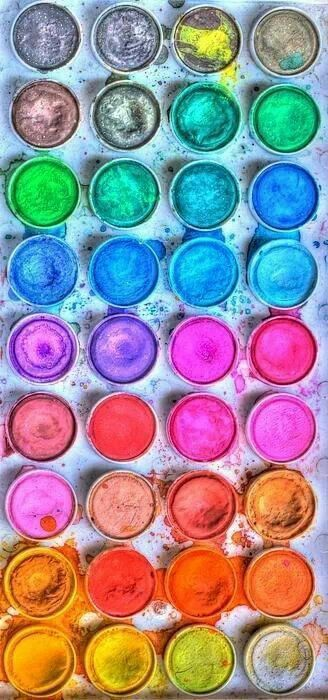 This is a picture of watercolors this picture has some warm colors for example (Red, Pink, and orange) and some cool colors like ( Green, Blue and purple) ~Holly Kell Art 6/01