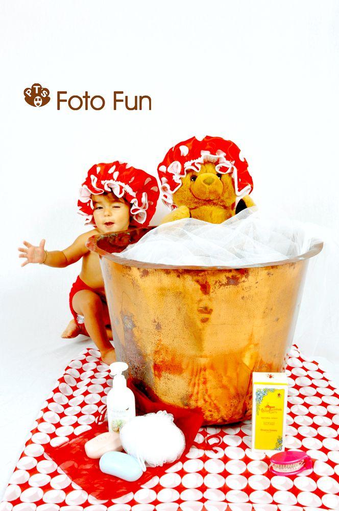 baby girl and teddy bear having an old style bath