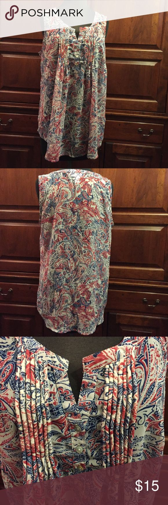 Motherhood loosefitting blouse Red blue and white sleeveless blouse. Button top with puckered material to give dimension. See picture.  Paisley style print Motherhood Maternity Tops Blouses