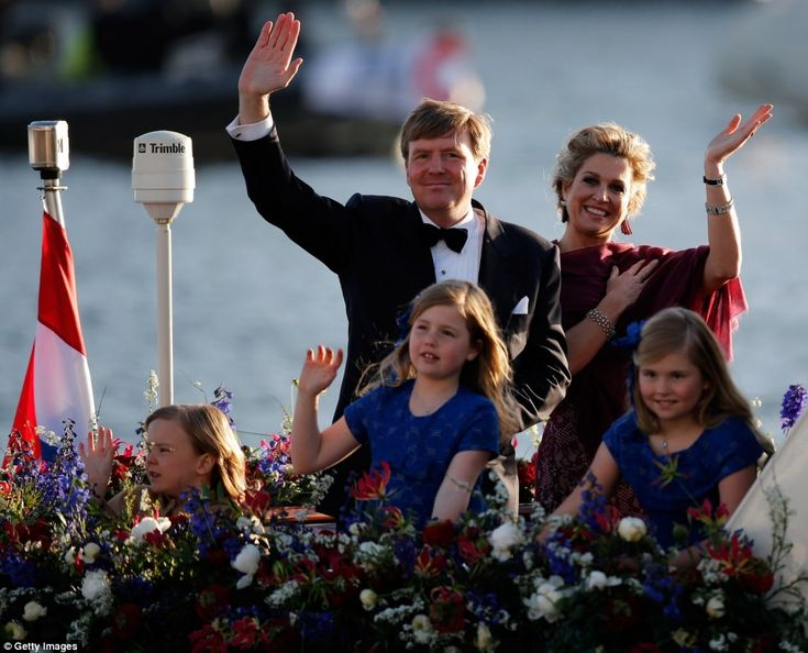 King of the river: The King and Queen smiling in the evening sun with their three daughters, from left, Princesses Ariane and Alexia and Crown Princess of Orange Catherine-Amalia