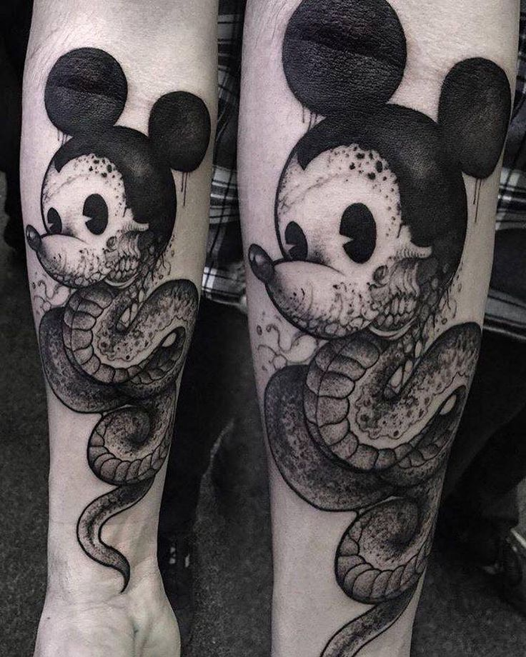 Snake Mickey Mouse tattoo.