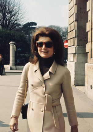 Classic Jackie in a Valentino camel coat and signature sunglasses during a trip to Paris, 1968
