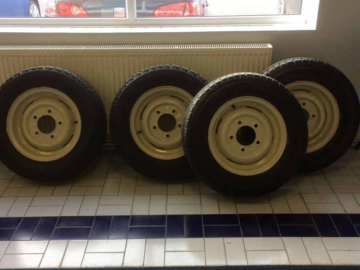 Four wheels cleaned and painted with fresh tyres and new inner tubes ready to be fitted to a cherished Series three LandRover. #Oakwell #Garages #Leyland #Tyres
