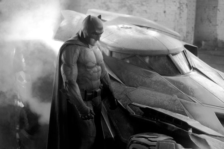 Brightened the new Batman suit picture for better view. I like the Dark Knight Returns elements in it.