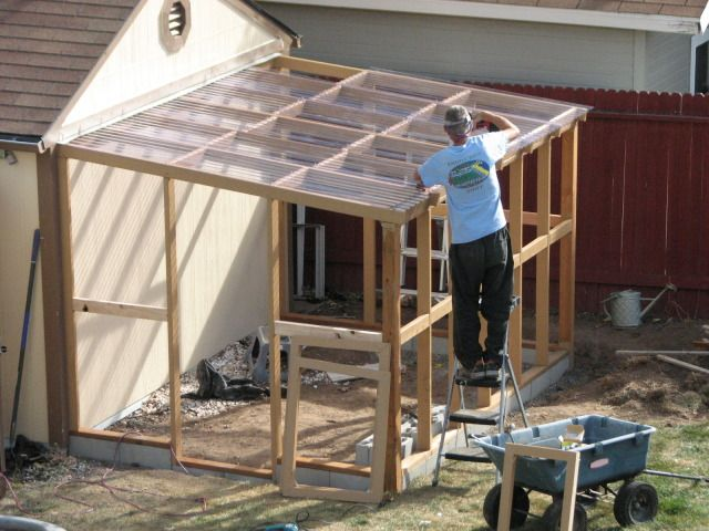 lean-to greenhouse (the sides could be draped with 6 mil poly that would be economical, and could be rolled up or removed in warm weather for ventilation)