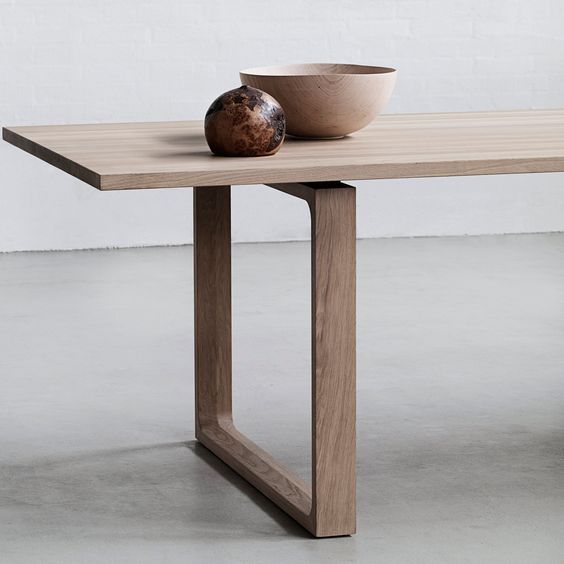 ... Essay Dining Table by Cecilie Manz effortlessly pairs natural solid  wood with simple modernist form to create this communal and contemporary  design.