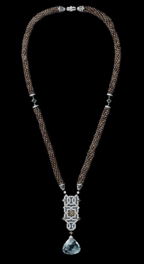 Oriental Influences – High Jewelry Necklace White gold, one 31.59-carat fan-shaped aquamarine, brown diamonds, Paraiba tourmalines, smoked quartz beads, plique à jour enamel, brilliants.