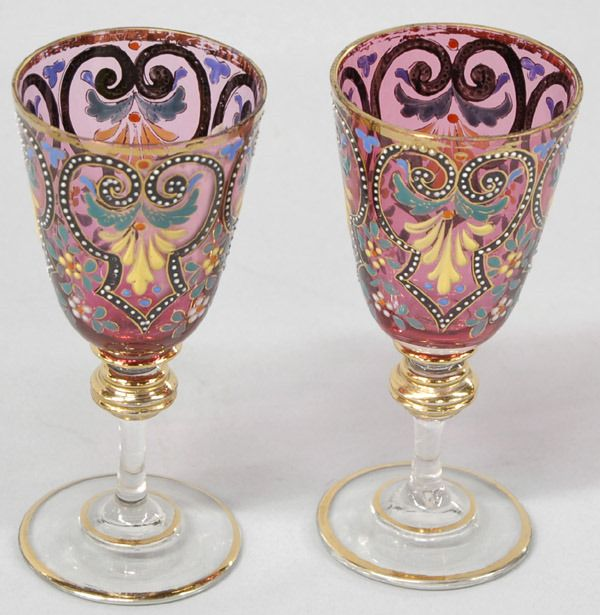 """Pair of Moser cranberry sherry glasses with enamel design and floral decorations, circa 1900, 5.25""""h"""