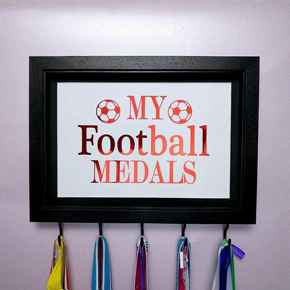 """Medal Holder For Football Medals Football Quote Soccer Foil Print   Perfect gift for Football players, big or small to display their medals. Whether its for 1 medal or many, show how proud you are of your football achievements by showing them off with this stylish medal display.  Foil quote reads """"My Football Medals"""" and has small footballs in the corner. Great gift for boys and girls."""