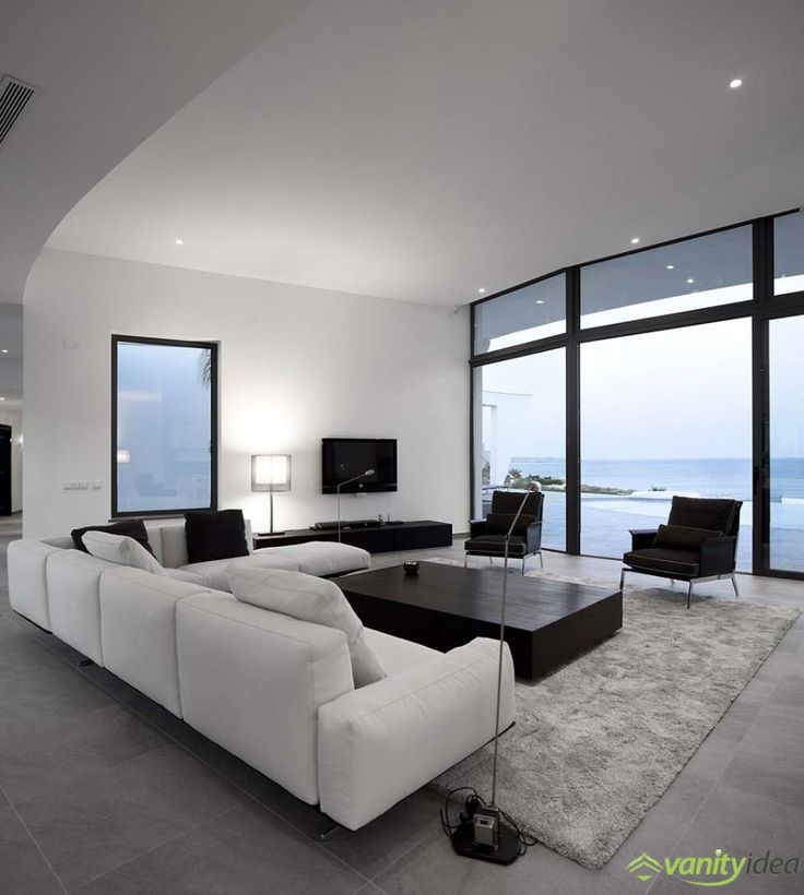 the livingroom is furnished modern and elegant with a gorgeous view at the sea