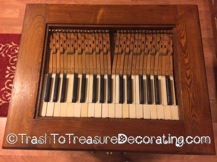 Table top made from upcycled old piano keys. Trash to Treasure Decorating: What to Do With an Old Piano - Upcycled Project
