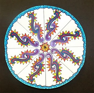 """Rotational Symmetry  I am pulling out an old lesson this week for my 4th graders who happen to be working on Rotational Symmetry.  I love teaching this lesson because the results are stunning, the kids feel confident about their work, and they want to work hard for the final product (which is sometimes a challenge).  I have the students create a simple drawing on 1/8 of their circle, then teach them how to """"transfer"""" their drawing into all 8 parts of their circle by putting pencil led on the…"""