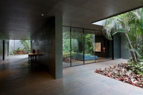 looks like the house from ex machina. Spasm Architects clad Indian house in local stone and wrap it around a sunken courtyard.