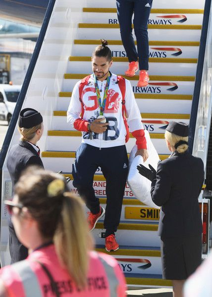 Gymnast Louis Smith wears his silver medal after arriving home at Heathrow Airport on August 23, 2016 in London, England. The 2016 British Olympic Team arrived back to Heathrow on a British Airways flight today having finished second in the medal table at the Rio Olympics. They totalled 67 medals including 27 Gold and 23 Silver in Great Britain's strongest Olympic performance in over a century.