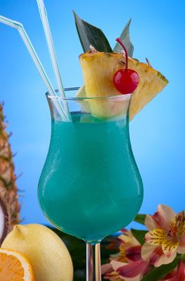 Blue Hawaii Cocktail-- Ingredients: * 3/4 oz. Light Rum * 3/4 oz. Vodka * 1/2 oz. Blue Caracao * 3 oz. Pineapple Juice * 1 oz. Sweet & Sour Mix  Preparation:  Combine all ingredients and mix well. If using ice, mix the ingredients in a blender. Serve in a tall glass. Garnish with a slice of pineapple and a cherry.