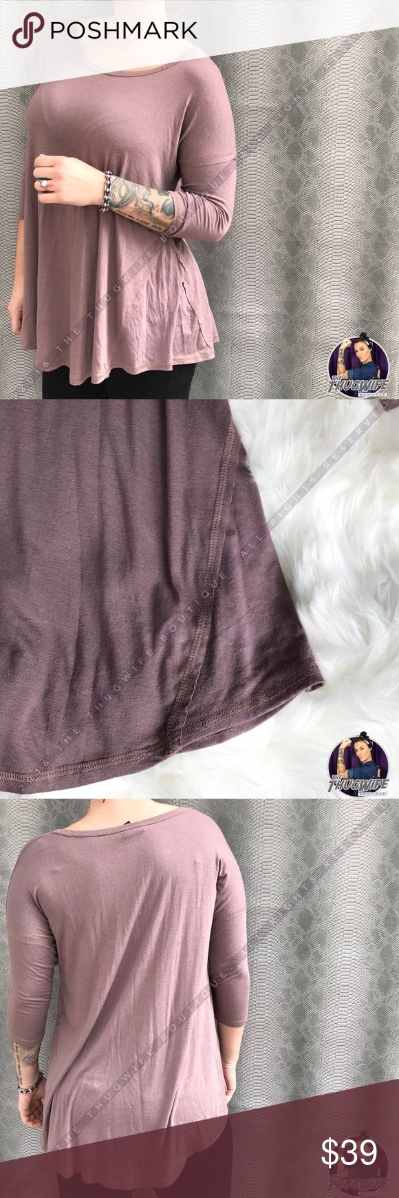 Rustic 3/4 sleeve trim tunic NEW WITH TAGS .       Casual cozy with this number ! Beautiful three quarter sleeve swoop scoop neck tunic .   The sleeves and wedges of waist have a fringe trim to give a little flare .  Pair with a long necklace and your favorite jeans and you're in heaven 😍   Use the OFFER BUTTON • bundle for 10% off   🤗 please no drama ladies lets be nice 🤗  • 5 star rating • 500+ sales  • smoke free home  • always 100% authentic  |💀| www.thethugwife.com |💀|   N O…