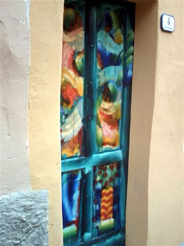 "Front door ... Artist Coilin Murray .. "" The village of Valloria in Liguria in Italy has all of its doors painted by artists ... Over the years more and more doors have been painted to make "" The Village of the Painted Doors """
