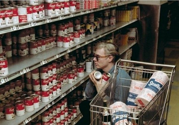 Andy Warhol buying soup cans in 1962. He was completely unknown when this photograph was taken.