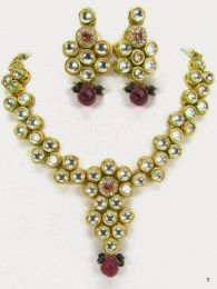 Scintillating Necklace Set Studded With CZ And Purple Stones