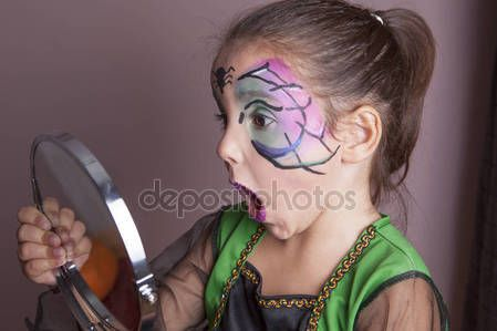 Little girl looking surprised into the mirror — Stock Photo © Juan_G_Aunion #131920210