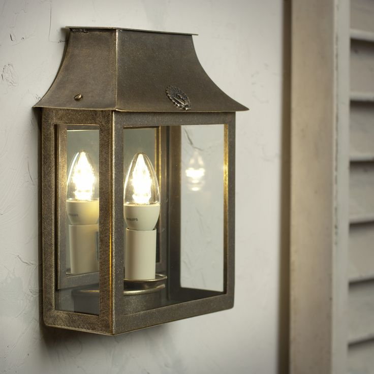 Peacock Wall Lantern in Antiqued Brass