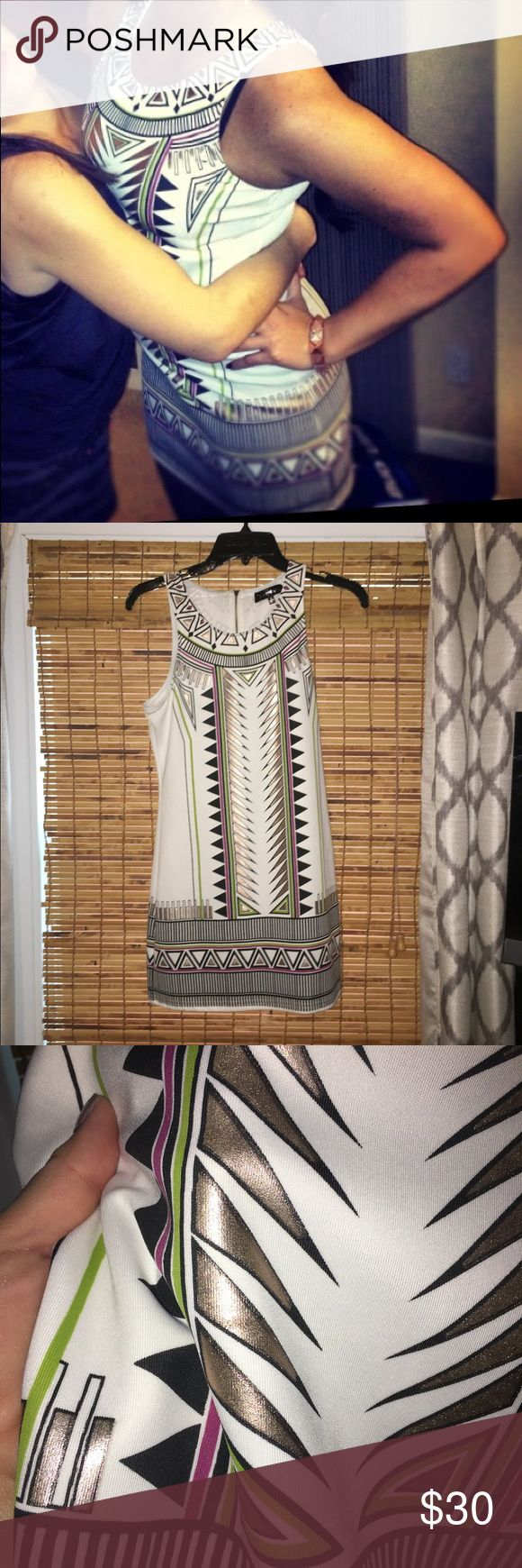 White Aztec print metallic dress This dress looks and feels expensive! Perfect for a night out with the girls. It's a size large but fits more like a medium. I got it from a boutique and have only worn it once (New Years eve). It's in great, like-new condition. Dresses Mini