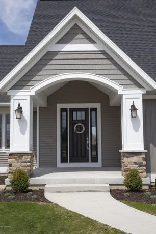 Traditional Front Door with Golden White Ledger Panel, GAF Weatherside Emphasis Shingle Siding, exterior stone floors
