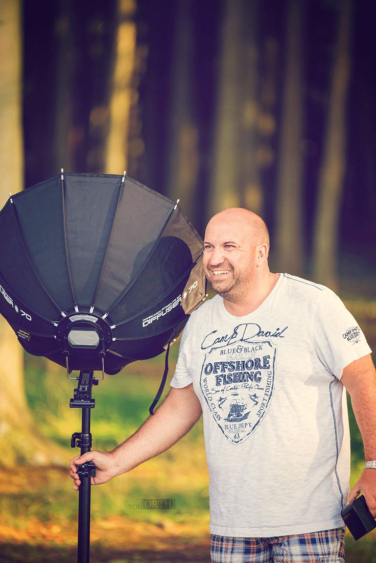 Mike Orth, photographer, working on a light setup at Rostock, Germany, Nienhagen