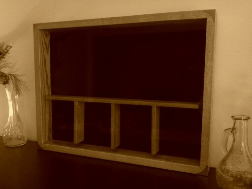 This Shadow Box is 18x24x3 and has 5 separate compartments.  This one was built for a Navy Commander who is about to retire.  It is made of ashwood, stained a honey colour and finished with clear urethane.  The back is covered in black felt and can either sit on a shelf or hang.  $125
